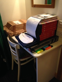 My desk on arrival... shoes, knife set and piles and piles of stationary