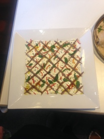 Labneh with anchovies, red chilli, nigella seeds and cucumber
