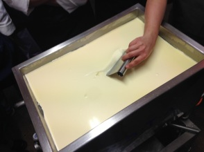 The first cut of the curds